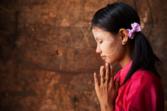 Myanmar girl in a praying pose. Stock Image