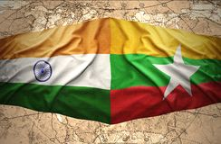 Myanmar and India. Waving Myanmar and Indian flags of the political map of the world Stock Image