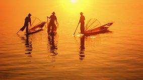 Myanmar, Inle Lake. Fishermen on vintage boats moved with legs stock video footage