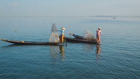 Myanmar, Inle Lake. Fishermen on vintage boats stock video footage