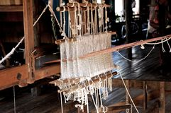 Myanmar, Inle lake: Loom at the silk factory Stock Photo