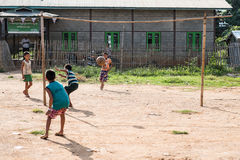 MYANMAR- INLE 15 OCT 2014: Kids playing football in inle 14 oct. 2014 from Myanmar Royalty Free Stock Photos