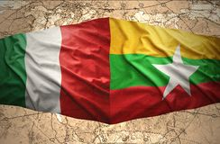 Myanmar and Italy. Waving Myanmar and  Italian flags of the political map of the world Royalty Free Stock Photos