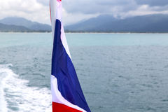 Myanmar kho   isle waving flag      south china sea Stock Photo