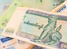 Myanmar Kyat banknote on another Southeast-asian currency bankn. Otes royalty free stock photo