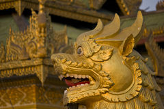 Myanmar Lion of the Temple. The Golden Swedagon Pagoda temple is situated inside the capital of Yangoon city in Myanmar. Detail of the Lion Stock Photography