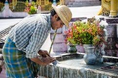 Myanmar man repair temple. Stock Photos