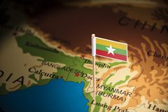 Myanmar marked with a flag on the map.  royalty free stock photos