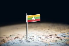 Myanmar marked with a flag on the map.  stock photo
