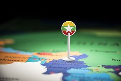 Myanmar marked with a flag on the map.  royalty free stock image
