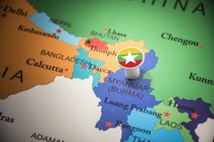 Myanmar marked with a flag on the map.  royalty free stock images