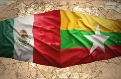 Myanmar and Mexico. Waving Myanmar and Mexican flags of the political map of the world Stock Image