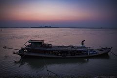 Myanmar - Mingun - house boat on Irrawaddy river. In the sunrise Stock Photos