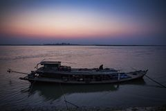 Myanmar - Mingun - house boat on Irrawaddy river. In the sunrise Royalty Free Stock Image