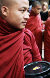 Myanmar monk carrying his bowl Stock Photography