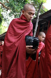 Myanmar monk carrying meal's bowl Royalty Free Stock Image