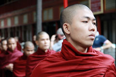 Myanmar monk in line Stock Photos