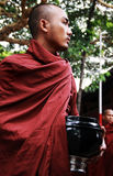 Myanmar monk with daily meal bowl Royalty Free Stock Photography