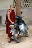 Myanmar monk with motorbike Stock Photo