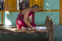 Myanmar monk's portait. Portrait of a Monk reading a book in Old Bagan in Myanmar (Burma)nnhttp://photography.nationalgeographic.com/photography/photo-of-the-day Royalty Free Stock Photography