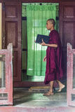 Myanmar monk`s. Young Monk reading a book in Old Bagan in Myanmar Burmannhttp://photography.nationalgeographic.com/photography/photo-of-the-day/monk-road-bagan Royalty Free Stock Images