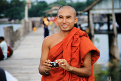 Myanmar monk taking a photo to a tourist Stock Photos