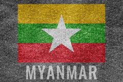 MYANMAR nation flag on jean texture design Stock Image