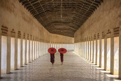 Myanmar Novice monk walking together in ancient pagoda Bagan Man. Dalay The Buddhism the best in Asia and a culture faith of people in Burma. And landmark of royalty free stock photography