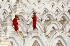 Myanmar novice two were climbing the pagoda royalty free stock image