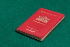 Free Myanmar Passport On Green Table Stock Image - 130213111