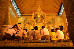 The Myanmar people venerated Buddha statue with the golden paper at Mahamuni Buddha temple Royalty Free Stock Photos