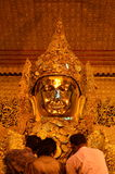 The Myanmar people venerated Buddha statue with the golden paper at Mahamuni Buddha temple Stock Photography
