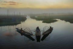Myanmar`s balancing fishermen in inle lake royalty free stock photos