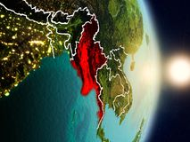 Myanmar during sunrise. Highlighted in red on planet Earth with visible country borders. 3D illustration. Elements of this image furnished by NASA Royalty Free Stock Photos