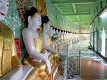 Myanmar, Sagaing Hill, Pagoda U Min Thonze with gilded Buddha images seated in crescent-shaped colonnade stock photo