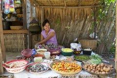 Myanmar Villager Selling Produce. Myinkaba Village, Myanmar - Oct 15: Unidentified villager selling produce at the local market in Myinkaba Village, Myanmar on Stock Photos