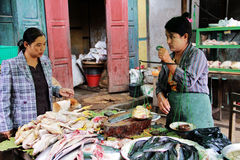 Myanmar woman weighing meat to sell Royalty Free Stock Photography