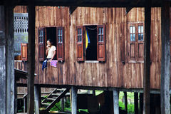 Myanmar woman at the window Royalty Free Stock Photos
