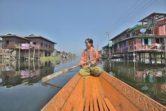 Myanmar Wooden Sampan canoe in channel stock image
