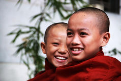 Myanmar young monks smiling Stock Photos