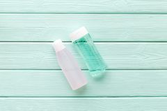 Mycelial water, lotion for skin care on mint green wooden background flat lay space for text stock photo