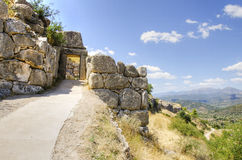 Mycenae gate, Greece. One of the gates at the historical site of Mycenae, in Greece. The pathway leeds into the main site where some of the ruins are located Stock Photos
