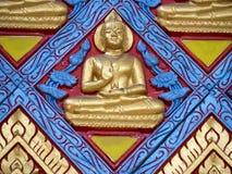 Mycket diagram av buddha på betongväggen Arkivbilder
