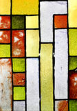 Mycket gammal glass yttersida färgade textur av ett antikt fönster Royaltyfria Bilder