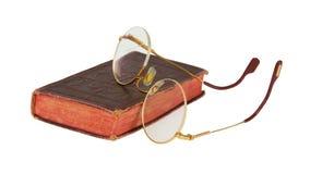 Mycket gammala exponeringsglas och röd en isolerad bok Arkivfoton