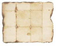 Mycket gammalt papper med brända kanter Arkivfoton