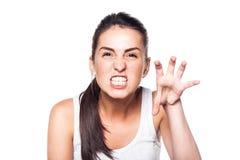 Mycket ilsken ung flicka på vit Royaltyfri Fotografi