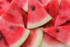 Mycket ljus mogen vattenmelon skivar bakgrund Arkivfoto