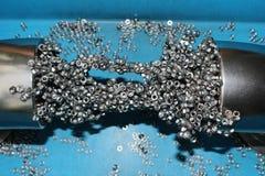Mycket metallmuttrar som till varandra magnetiseras Royaltyfri Fotografi