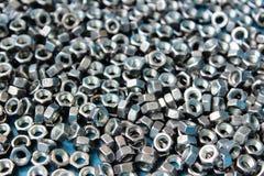 Mycket metallmuttrar som till varandra magnetiseras Royaltyfri Foto